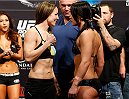 LAS VEGAS, NV - FEBRUARY 21:  (L-R) Opponents Alexis Davis and Jessica Eye face off during the UFC 170 weigh-in event at the Mandalay Bay Events Center on February 21, 2014 in Las Vegas, Nevada. (Photo by Josh Hedges/Zuffa LLC/Zuffa LLC via Getty Images)