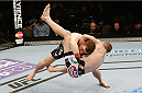 LAS VEGAS, NV - FEBRUARY 22:  Zach Makovsky (red tape) takes down Josh Sampo in their flyweight bout during UFC 170 inside the Mandalay Bay Events Center on February 22, 2014 in Las Vegas, Nevada. (Photo by Josh Hedges/Zuffa LLC/Zuffa LLC via Getty Images) *** Local Caption *** Zach Makovsky; Josh Sampo
