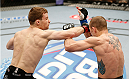 LAS VEGAS, NV - FEBRUARY 22:  (L-R) Zach Makovsky punches Josh Sampo in their flyweight bout during UFC 170 inside the Mandalay Bay Events Center on February 22, 2014 in Las Vegas, Nevada. (Photo by Josh Hedges/Zuffa LLC/Zuffa LLC via Getty Images) *** Local Caption *** Zach Makovsky; Josh Sampo