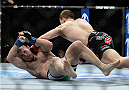 LAS VEGAS, NV - FEBRUARY 22:  Zach Makovsky (top) punches Josh Sampo in their flyweight bout during UFC 170 inside the Mandalay Bay Events Center on February 22, 2014 in Las Vegas, Nevada. (Photo by Jeff Bottari/Zuffa LLC/Zuffa LLC via Getty Images) *** Local Caption *** Zach Makovsky; Josh Sampo