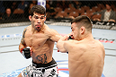 LAS VEGAS, NV - FEBRUARY 22:  (L-R) Raphael Assuncao punches Pedro Munhoz in their bantamweight bout during UFC 170 inside the Mandalay Bay Events Center on February 22, 2014 in Las Vegas, Nevada. (Photo by Josh Hedges/Zuffa LLC/Zuffa LLC via Getty Images) *** Local Caption *** Raphael Assuncao; Pedro Munhoz