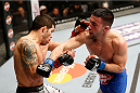 LAS VEGAS, NV - FEBRUARY 22:  (R-L) Pedro Munhoz punches Raphael Assuncao in their bantamweight bout during UFC 170 inside the Mandalay Bay Events Center on February 22, 2014 in Las Vegas, Nevada. (Photo by Josh Hedges/Zuffa LLC/Zuffa LLC via Getty Images) *** Local Caption *** Raphael Assuncao; Pedro Munhoz