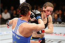 LAS VEGAS, NV - FEBRUARY 22:  (R-L) Alexis Davis punches Jessica Eye in their women's bantamweight bout during UFC 170 inside the Mandalay Bay Events Center on February 22, 2014 in Las Vegas, Nevada. (Photo by Josh Hedges/Zuffa LLC/Zuffa LLC via Getty Images) *** Local Caption *** Alexis Davis; Jessica Eye