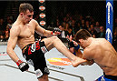 LAS VEGAS, NV - FEBRUARY 22:  (L-R) Rory MacDonald kicks Demian Maia in their welterweight bout during UFC 170 inside the Mandalay Bay Events Center on February 22, 2014 in Las Vegas, Nevada. (Photo by Josh Hedges/Zuffa LLC/Zuffa LLC via Getty Images) *** Local Caption *** Rory MacDonald; Demian Maia