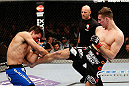 LAS VEGAS, NV - FEBRUARY 22:  (R-L) Rory MacDonald kicks Demian Maia in their welterweight bout during UFC 170 inside the Mandalay Bay Events Center on February 22, 2014 in Las Vegas, Nevada. (Photo by Josh Hedges/Zuffa LLC/Zuffa LLC via Getty Images) *** Local Caption *** Rory MacDonald; Demian Maia