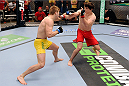 LACHUTE, CANADA - NOVEMBER 20:  (L-R) Team Australia fighter Jake Matthews takes on Team Canada fighter Olivier Aubin-Mercier in their welterweight fight during filming of The Ultimate Fighter Nations television series on November 20, 2013 in Lachute, Quebec, Canada. (Photo by Richard Wolowicz/Zuffa LLC/Zuffa LLC via Getty Images) *** Local Caption *** Jake Matthews; Olivier Aubin-Mercier
