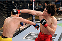 LACHUTE, CANADA - NOVEMBER 20:  (R-L) Team Canada fighter Olivier Aubin-Mercier punches Team Australia fighter Jake Matthews in their welterweight fight during filming of The Ultimate Fighter Nations television series on November 20, 2013 in Lachute, Quebec, Canada. (Photo by Richard Wolowicz/Zuffa LLC/Zuffa LLC via Getty Images) *** Local Caption *** Jake Matthews; Olivier Aubin-Mercier