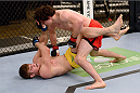 LACHUTE, CANADA - NOVEMBER 20:  (R-L) Team Canada fighter Olivier Aubin-Mercier takes down Team Australia fighter Jake Matthews in their welterweight fight during filming of The Ultimate Fighter Nations television series on November 20, 2013 in Lachute, Quebec, Canada. (Photo by Richard Wolowicz/Zuffa LLC/Zuffa LLC via Getty Images) *** Local Caption *** Jake Matthews; Olivier Aubin-Mercier