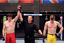 LACHUTE, CANADA - NOVEMBER 20:  (L-R) Team Canada fighter Olivier Aubin-Mercier celebrates after defeating Team Australia fighter Jake Matthews in their welterweight fight during filming of The Ultimate Fighter Nations television series on November 20, 2013 in Lachute, Quebec, Canada. (Photo by Richard Wolowicz/Zuffa LLC/Zuffa LLC via Getty Images) *** Local Caption *** Jake Matthews; Olivier Aubin-Mercier