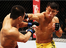 MACAU - MARCH 01:  Wang Sai throws a punch at Lipeng Zhang in their TUF China welterweight finals fight during the UFC Fight Night event at the Venetian Macau on March 1, 2014 in Macau. (Photo by Mitch Viquez/Zuffa LLC/Zuffa LLC via Getty Images)
