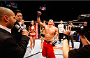 MACAU - MARCH 01:  Lipeng Zhang celebrates after his win over Wang Sai in their TUF China welterweight finals fight during the UFC Fight Night event at the Venetian Macau on March 1, 2014 in Macau. (Photo by Mitch Viquez/Zuffa LLC/Zuffa LLC via Getty Images)