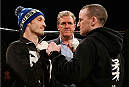 LONDON, ENGLAND - MARCH 05:  (L-R) Opponents Brad Pickett and Neil Seery face off after an open training session for fans and media at One Embankment on March 5, 2014 in London, England. (Photo by Josh Hedges/Zuffa LLC/Zuffa LLC via Getty Images)