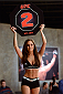 LACHUTE, CANADA - DECEMBER 2:  UFC Octagon Girl Stephanie Serfaty signals the start of round two between Team Australia fighter Vik Grujic and Team Canada fighter Luke Harris in their middleweight fight during filming of The Ultimate Fighter Nations television series on December 2, 2013 in Lachute, Quebec, Canada. (Photo by Richard Wolowicz/Zuffa LLC/Zuffa LLC via Getty Images) *** Local Caption *** Stephanie Serfaty