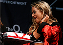 LONDON, ENGLAND - MARCH 07:  UFC Octagon Girl Carly Baker is presented with a cake on her birthday during the UFC weigh-in event at the O2 Arena on March 7, 2014 in London, England. (Photo by Josh Hedges/Zuffa LLC/Zuffa LLC via Getty Images)