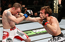 LONDON, ENGLAND - MARCH 08:  (R-L) Brad Pickett punches Neil Seery in their flyweight fight during the UFC Fight Night London event at the O2 Arena on March 8, 2014 in London, England. (Photo by Josh Hedges/Zuffa LLC/Zuffa LLC via Getty Images)