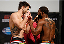 DALLAS, TX - MARCH 14:  (L-R) Opponents Carlos Condit and Tyron Woodley face off during the UFC 171 official weigh-in at Gilley's Dallas on March 14, 2014 in Dallas, Texas. (Photo by Josh Hedges/Zuffa LLC/Zuffa LLC via Getty Images)