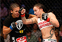 DALLAS, TX - MARCH 15:  (R-L) Raquel Pennington punches Jessica Andrade in their women's bantamweight bout at UFC 171 inside American Airlines Center on March 15, 2014 in Dallas, Texas. (Photo by Josh Hedges/Zuffa LLC/Zuffa LLC via Getty Images)