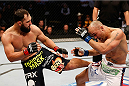 DALLAS, TX - MARCH 15:  (L-R) Johny Hendricks kicks Robbie Lawler in their UFC welterweight championship bout at UFC 171 inside American Airlines Center on March 15, 2014 in Dallas, Texas. (Photo by Josh Hedges/Zuffa LLC/Zuffa LLC via Getty Images)