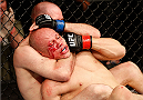 NATAL, BRAZIL - MARCH 23:  (L-R) Kenny Robertson secures a rear choke submission against Thiago Perpetuo in their welterweight bout during the UFC Fight Night event at Ginasio Nelio Dias on March 23, 2014 in Natal, Brazil. (Photo by Josh Hedges/Zuffa LLC/Zuffa LLC via Getty Images)