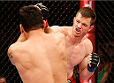 "NATAL, BRAZIL - MARCH 23:  (R-L) CB Dollaway punches Cezar ""Mutante"" Ferreira in their middleweight bout during the UFC Fight Night event at Ginasio Nelio Dias on March 23, 2014 in Natal, Brazil. (Photo by Josh Hedges/Zuffa LLC/Zuffa LLC via Getty Images)"