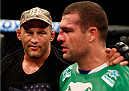 NATAL, BRAZIL - MARCH 23:  (L-R) Dan Henderson provides words of encouragement for Mauricio