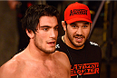 LACHUTE, CANADA - DECEMBER 6:  (R-L) Team Canada Coach Patrick Cote congratulates his fighter Elias Theodorou after defeating Team Australia fighter Tyler Manawaroa in their semifinal middleweight fight during filming of The Ultimate Fighter Nations television series on December 6, 2013 in Lachute, Quebec, Canada. (Photo by Richard Wolowicz/Zuffa LLC/Zuffa LLC via Getty Images) *** Local Caption *** Patrick Cote; Elias Theodorou