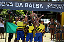 SAO PAULO, BRAZIL - JANUARY 22:  Team Wanderlei celebrate as they beat Team Sonnen to the beach in the water challenge during season three of The Ultimate Fighter Brazil on January 22, 2014 in Sao Paulo, Brazil. (Photo by Luiz Pires Dias/Zuffa LLC/Zuffa LLC via Getty Images) *** Local Caption ***