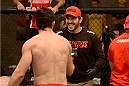 LACHUTE, CANADA - DECEMBER 9:  (R-L) Team Canada Coach Patrick Cote congratulates Team Canada fighter Sheldon Wescott after defeating Team Australia fighter Vic Grujic in their semifinal middleweight fight during filming of The Ultimate Fighter Nations television series on December 9, 2013 in Lachute, Quebec, Canada. (Photo by Richard Wolowicz/Zuffa LLC/Zuffa LLC via Getty Images) *** Local Caption *** Sheldon Wescott; Patrick Cote
