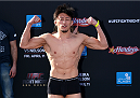 ABU DHABI, UNITED ARAB EMIRATES - APRIL 10:  Tatsuya Kawajiri of Japan poses as he weighs-in for UFC Fight Night 39 on April 10, 2014 in Abu Dhabi, United Arab Emirates. UFC Fight Night 39 will take place on April 11 at du Arena featuring Antonio Rodrigo Nogueira and Roy Nelson.  (Photo by Warren Little/Zuffa LLC/Zuffa LLC via Getty Images)
