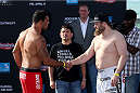 ABU DHABI, UNITED ARAB EMIRATES - APRIL 10:  Antonio Rodrigo Nogueira and Roy Nelson shake hands after they weigh-in for UFC Fight Night 39 on April 10, 2014 in Abu Dhabi, United Arab Emirates. UFC Fight Night 39 will take place on April 11 at du Arena featuring  Minotauro Nogueira and Roy