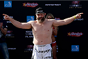 ABU DHABI, UNITED ARAB EMIRATES - APRIL 10:  Roy Nelson steps on the scale as he weighs-in for UFC Fight Night 39 on April 10, 2014 in Abu Dhabi, United Arab Emirates. UFC Fight Night 39 will take place on April 11 at du Arena featuring  Minotauro Nogueira and Roy