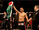 ABU DHABI, UNITED ARAB EMIRATES - APRIL 11:  Ramsey Nijem celebrates his TKO victory against Beneil Dariush after their bout during UFC Fight Night 39 at du Arena on April 11, 2014 in Abu Dhabi, United Arab Emirates.  (Photo by Warren Little/Zuffa LLC/Zuffa LLC via Getty Images)