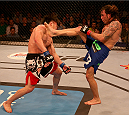 ABU DHABI, UNITED ARAB EMIRATES - APRIL 11:  (R-L) Clay Guida kicks Tatsuya Kawajiri of Japan during their bout during UFC Fight Night 39 at du Arena on April 11, 2014 in Abu Dhabi, United Arab Emirates.  (Photo by Warren Little/Zuffa LLC/Zuffa LLC via Getty Images)