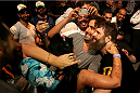 ABU DHABI, UNITED ARAB EMIRATES - APRIL 11:  Roy Nelson celebrates his knockout victory against Antonio Rodrigo Nogueira with fans after their heavyweight bout during UFC Fight Night 39 at du Arena on April 11, 2014 in Abu Dhabi, United Arab Emirates.  (Photo by Warren Little/Zuffa LLC/Zuffa LLC via Getty Images)