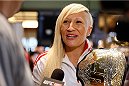 QUEBEC CITY, CANADA - APRIL 13:  Canadian Olympic gold medalist Kaillie Humphries interacts with media during the UFC open workouts at the Centre Commercial Place Fleur de Lys on April 13, 2014 in Quebec City, Quebec, Canada. (Photo by Josh Hedges/Zuffa LLC/Zuffa LLC via Getty Images)