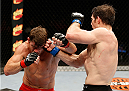 QUEBEC CITY, CANADA - APRIL 16:  (R-L) Tim Kennedy punches Michael Bisping in their middleweight fight during the TUF Nations Finale at Colisee Pepsi on April 16, 2014 in Quebec City, Quebec, Canada. (Photo by Josh Hedges/Zuffa LLC/Zuffa LLC via Getty Images)