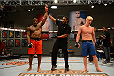 LAS VEGAS, NV - OCTOBER 16:  (L-R) Eddie Gordon celebrates after defeating Matt Gabel in their elimination fight during filming of season nineteen of The Ultimate Fighter on October 16, 2013 in Las Vegas, Nevada. (Photo by Al Powers/Zuffa LLC/Zuffa LLC via Getty Images) *** Local Caption *** Eddie Gordon; Matt Gabel