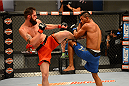 LAS VEGAS, NV - OCTOBER 16:  (R-L) Dhiego Lima blocks a kick from Adam Stroup in their elimination fight during filming of season nineteen of The Ultimate Fighter on October 16, 2013 in Las Vegas, Nevada. (Photo by Al Powers/Zuffa LLC/Zuffa LLC via Getty Images) *** Local Caption *** Dhiego Lima; Adam Stroup