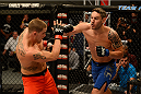 LAS VEGAS, NV - OCTOBER 16:  (R-L) Chris Fields punches Josh Stansbury in their elimination fight during filming of season nineteen of The Ultimate Fighter on October 16, 2013 in Las Vegas, Nevada. (Photo by Al Powers/Zuffa LLC/Zuffa LLC via Getty Images) *** Local Caption *** Chris Fields; Josh Stansbury