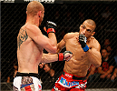 ORLANDO, FL - APRIL 19:  Edson Barboza (R) falls to the canvas after a left hand by Donald