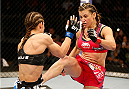 ORLANDO, FL - APRIL 19:  (R-L) Miesha Tate kicks Liz Carmouche in their women's bantamweight bout during the FOX UFC Saturday event at the Amway Center on April 19, 2014 in Orlando, Florida. (Photo by Josh Hedges/Zuffa LLC/Zuffa LLC via Getty Images)