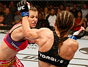 ORLANDO, FL - APRIL 19:  (L-R) Miesha Tate punches Liz Carmouche in their women's bantamweight bout during the FOX UFC Saturday event at the Amway Center on April 19, 2014 in Orlando, Florida. (Photo by Josh Hedges/Zuffa LLC/Zuffa LLC via Getty Images)
