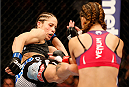 ORLANDO, FL - APRIL 19:  (L-R) Liz Carmouche kicks Miesha Tate in their women's bantamweight bout during the FOX UFC Saturday event at the Amway Center on April 19, 2014 in Orlando, Florida. (Photo by Josh Hedges/Zuffa LLC/Zuffa LLC via Getty Images)
