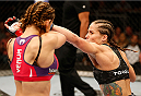 ORLANDO, FL - APRIL 19:  (R-L) Liz Carmouche punches Miesha Tate in their women's bantamweight bout during the FOX UFC Saturday event at the Amway Center on April 19, 2014 in Orlando, Florida. (Photo by Josh Hedges/Zuffa LLC/Zuffa LLC via Getty Images)