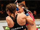 ORLANDO, FL - APRIL 19:  (R-L) Miesha Tate punches Liz Carmouche in their women's bantamweight bout during the FOX UFC Saturday event at the Amway Center on April 19, 2014 in Orlando, Florida. (Photo by Josh Hedges/Zuffa LLC/Zuffa LLC via Getty Images)