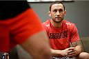 LAS VEGAS, NV - OCTOBER 24:  Coach Frankie Edgar instructs his fighter Hector Urbina before facing Team Penn fighter Cathal Pendred in their preliminary fight during filming of season nineteen of The Ultimate Fighter on October 24, 2013 in Las Vegas, Nevada. (Photo by Jeff Bottari/Zuffa LLC/Zuffa LLC via Getty Images) *** Local Caption *** Frankie Edgar