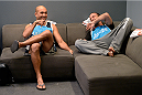 LAS VEGAS, NV - OCTOBER 24:  (L-R) Coach BJ Penn and boxing coach Jason Parillo share a laugh in the locker room before fighter Cathal Pendred faces Team Edgar fighter Hector Urbina in their preliminary fight during filming of season nineteen of The Ultimate Fighter on October 24, 2013 in Las Vegas, Nevada. (Photo by Jeff Bottari/Zuffa LLC/Zuffa LLC via Getty Images) *** Local Caption *** BJ Penn; Jason Parillo