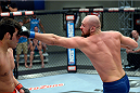 LAS VEGAS, NV - OCTOBER 24:  (R-L) Team Penn fighter Cathal Pendred punches Team Edgar fighter Hector Urbina in their preliminary fight during filming of season nineteen of The Ultimate Fighter on October 24, 2013 in Las Vegas, Nevada. (Photo by Jeff Bottari/Zuffa LLC/Zuffa LLC via Getty Images) *** Local Caption *** Hector Urbina; Cathal Pendred