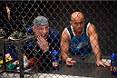 LAS VEGAS, NV - OCTOBER 24:  (R-L) Coach BJ Penn and wrestling coach Mark Coleman yell strategy to Team Penn fighter Cathal Pendred during his matchup against Team Edgar fighter Hector Urbina in their preliminary fight during filming of season nineteen of The Ultimate Fighter on October 24, 2013 in Las Vegas, Nevada. (Photo by Jeff Bottari/Zuffa LLC/Zuffa LLC via Getty Images) *** Local Caption *** BJ Penn; Mark Coleman