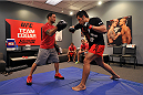 LAS VEGAS, NV - OCTOBER 24:  (L-R) Coach Frankie Edgar trains his fighter Hector Urbina before facing Team Penn fighter Cathal Pendred in their preliminary fight during filming of season nineteen of The Ultimate Fighter on October 24, 2013 in Las Vegas, Nevada. (Photo by Jeff Bottari/Zuffa LLC/Zuffa LLC via Getty Images) *** Local Caption *** Frankie Edgar; Hector Urbina
